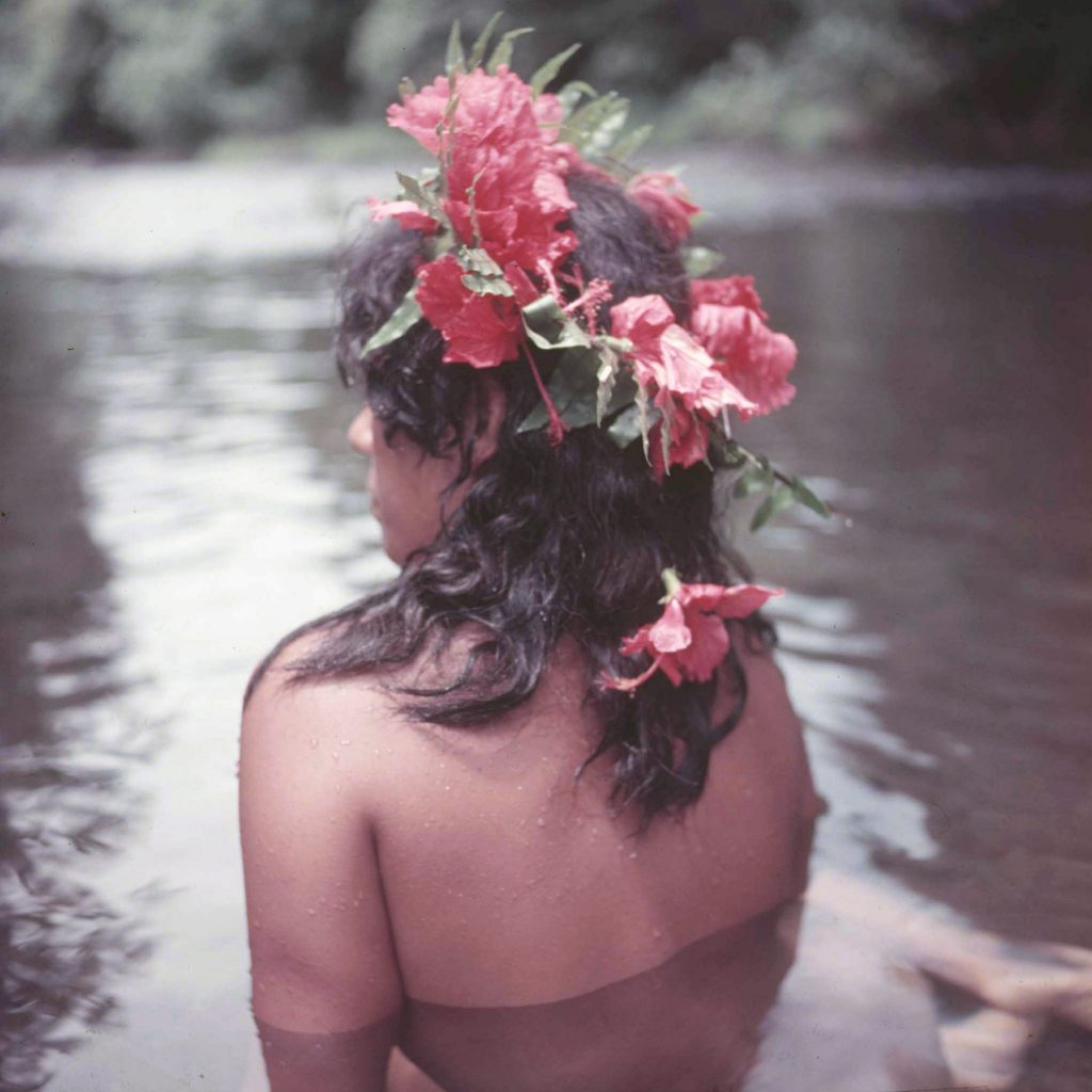 Tahitian girl bathing.