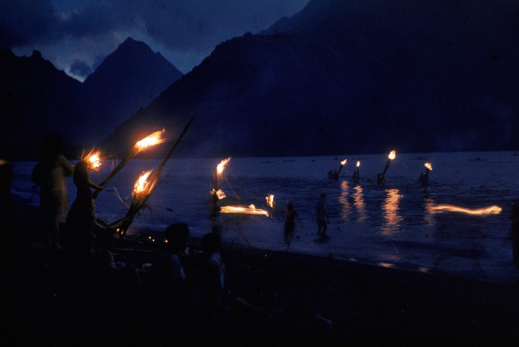Fiery greeting for canoes in Tahiti.