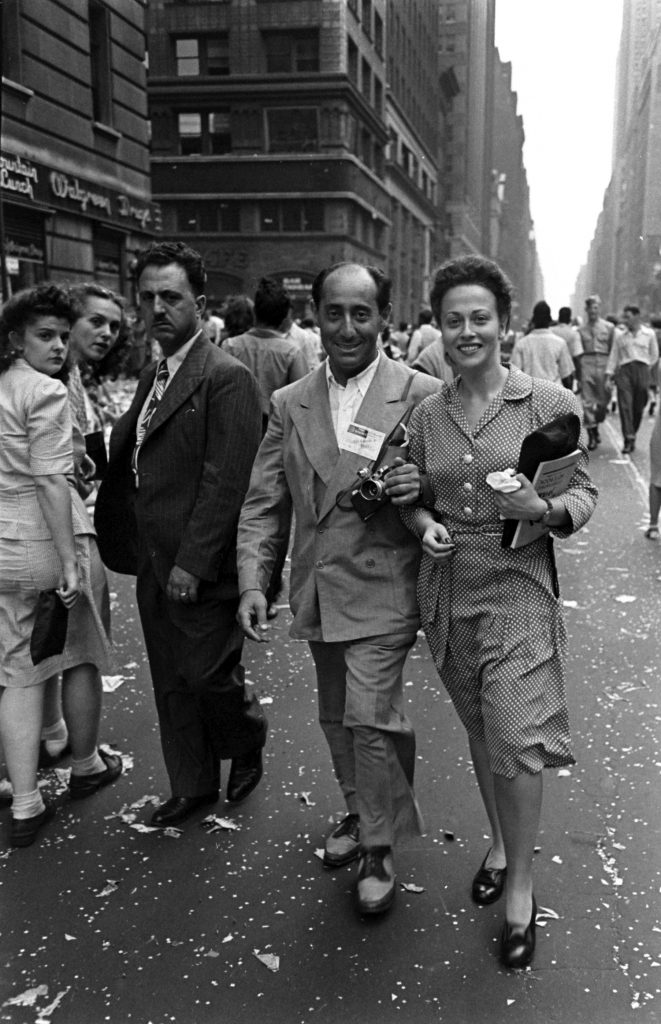 LIFE photographer Alfred Eisenstaedt and a reporter during V-J Day celebrations in Times Square, August 14, 1945.