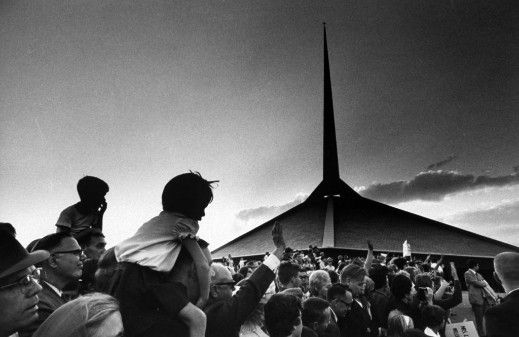 Crowds out side of the North Christian Church designed by Eero Saarinen, 1967.