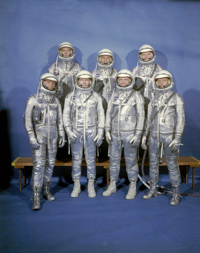 Project Mercury astronauts wearing pressure suits (top L-R) Alan Shepard, Virgil Grissom; Leroy Cooper; (bottom L-R) Walter Schirra, Donald Slayton, John Glenn, & Malcolm Carpenter.