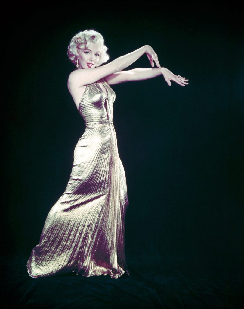 "Actress Marilyn Monroe posing wearing her famous gold lame gown for the motion picture ""Gentlemen Prefer Blondes."""