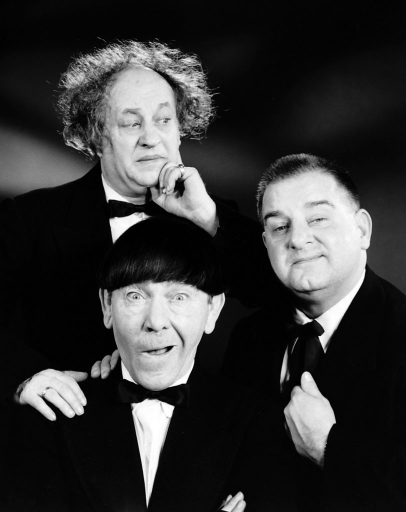 Comedy group The Three Stooges (clockwise from L): Curly Joe DeRita, Moe Howard, Larry Fine.