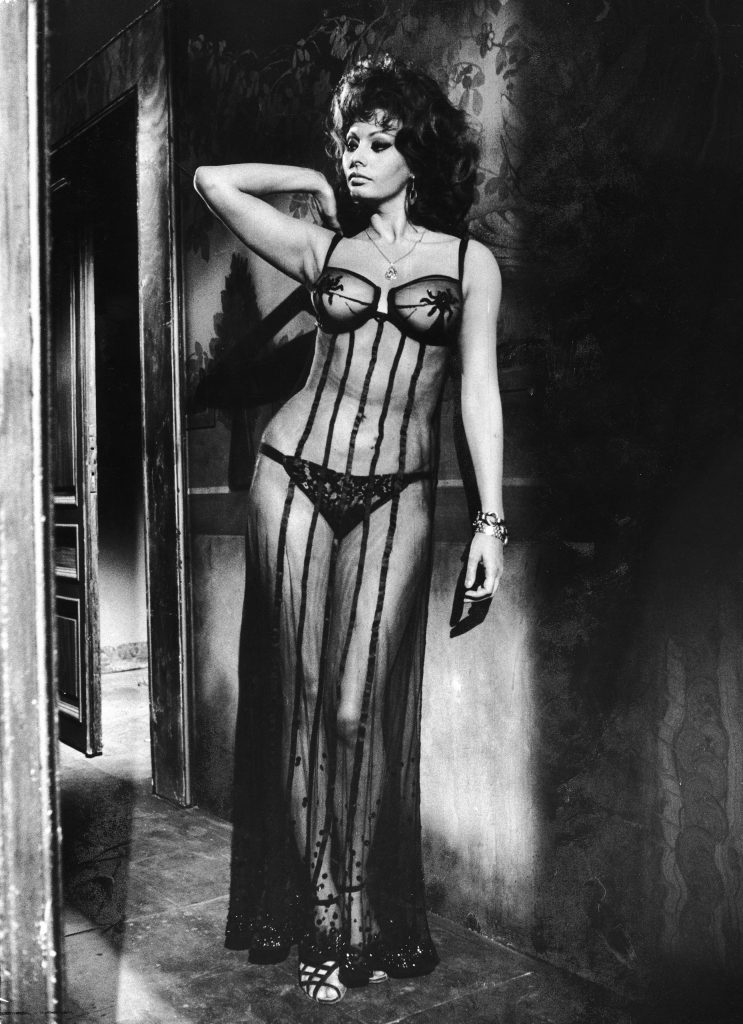 "Sophia Loren costumed in sheer gown in brothel scene from the movie ""Marriage Italian Style."""