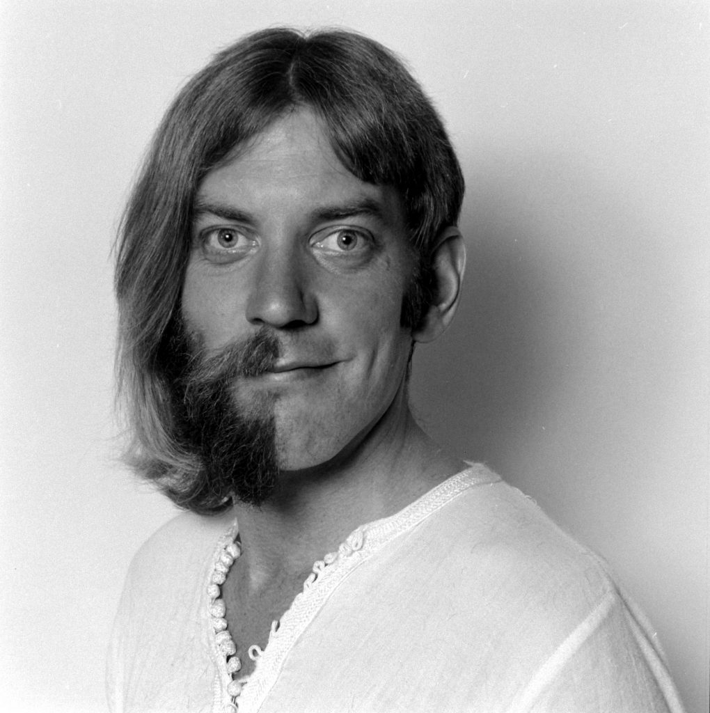 Humorous portrait of half shaved actor Donald Sutherland.