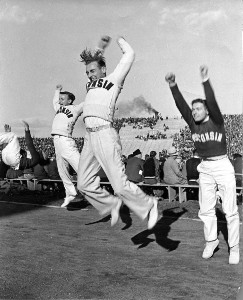 Male cheerleaders in action at Wisconsin-Marquette football game, 1939.