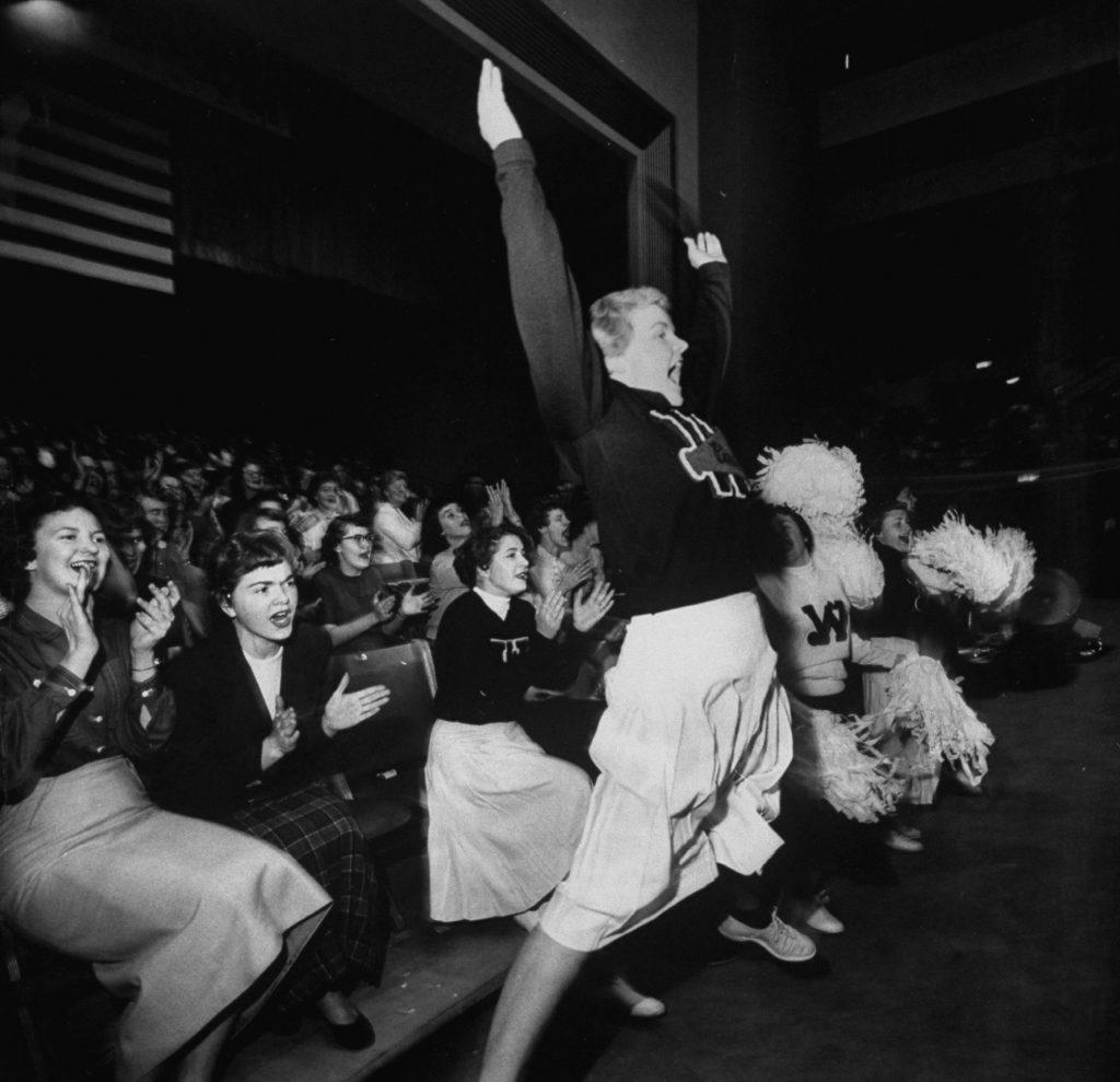Cheering section of cheerleaders in Spokane Coliseum, 1954.