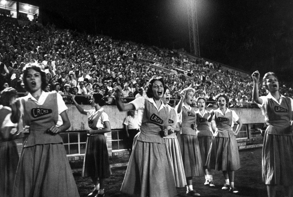 Cheerleaders at Little Rock high school game with Louisiana high school team, 1958.