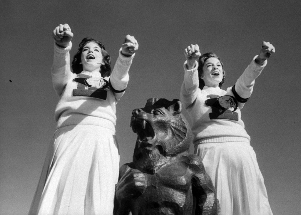 Lawrence High School cheerleaders during football game, 1960.