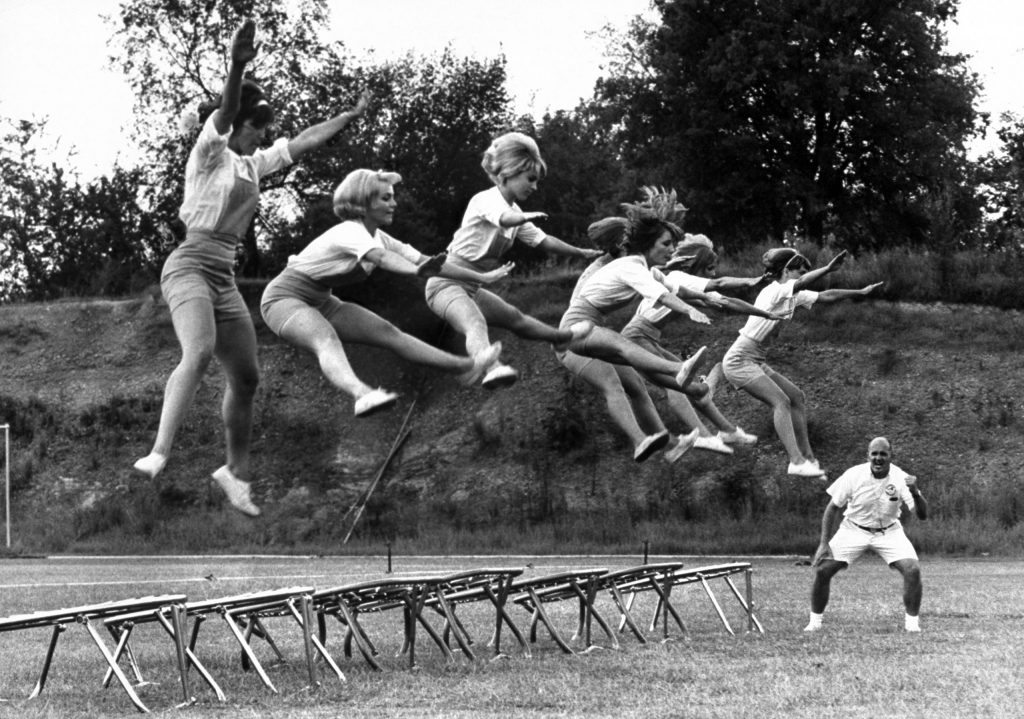 Cheerleaders training under Bill Horan, of the American Cheerleaders Assn.; Florence Alabama State College, 1965.