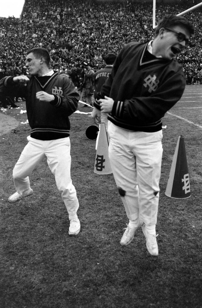 """Notre Dame cheerleaders work the crowd during the 1966 """"Game of the Century"""" against Michigan State, 1966."""