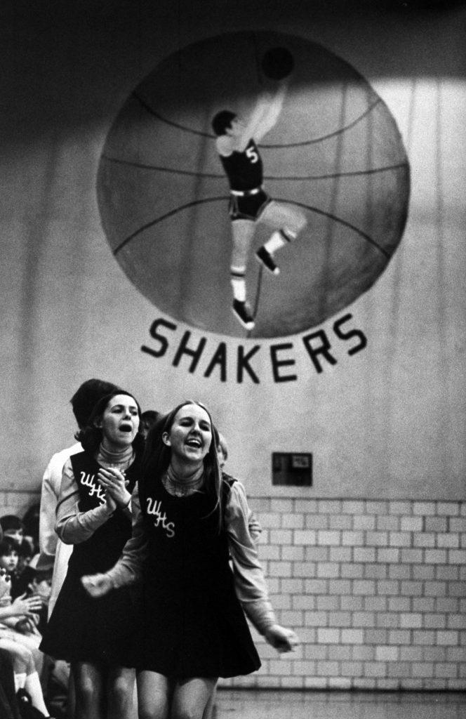 Cheerleaders cheering for a high school basketball game, 1971.