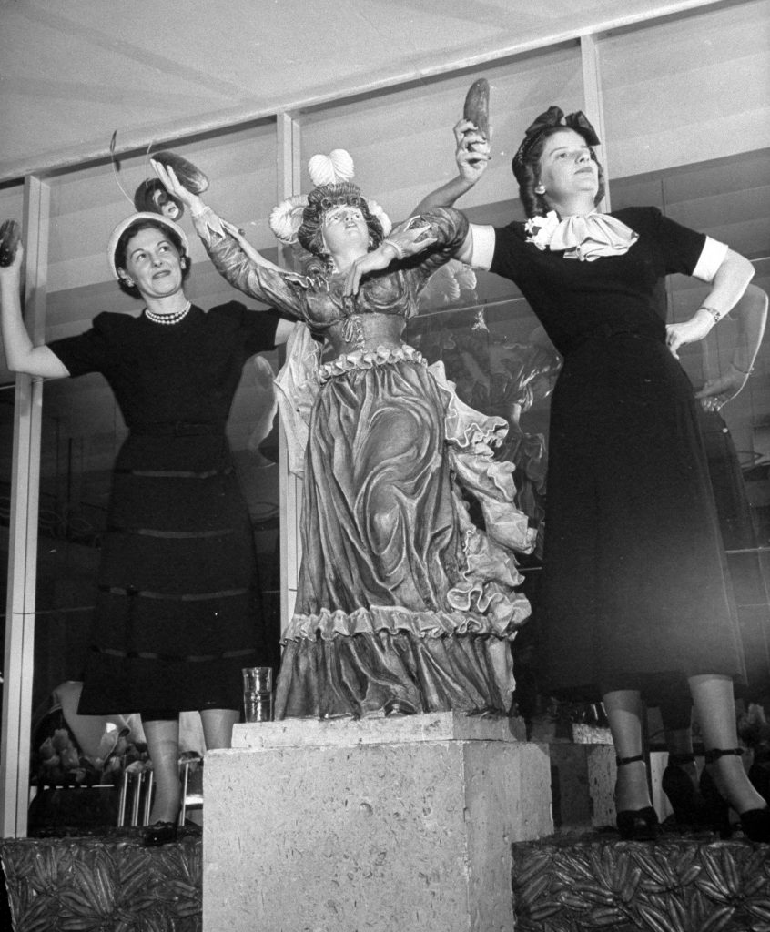 Models showing off pickles for National Pickle Week, 1949.