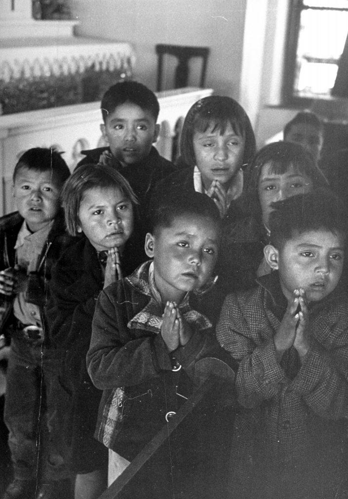 Navajo children receiving religious instruction.