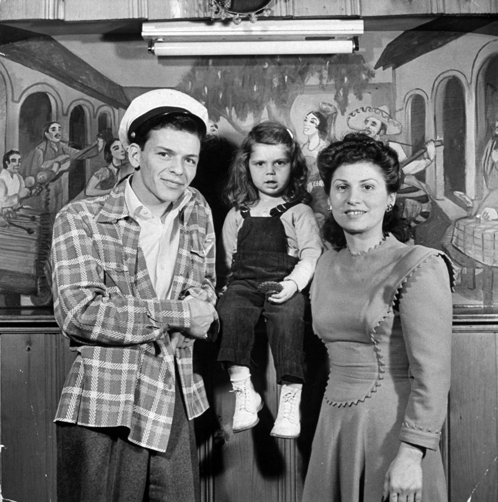 Frank Sinatra with wife Nancy and 3 yr-old daughter Nancy Jr.at home, 1943.