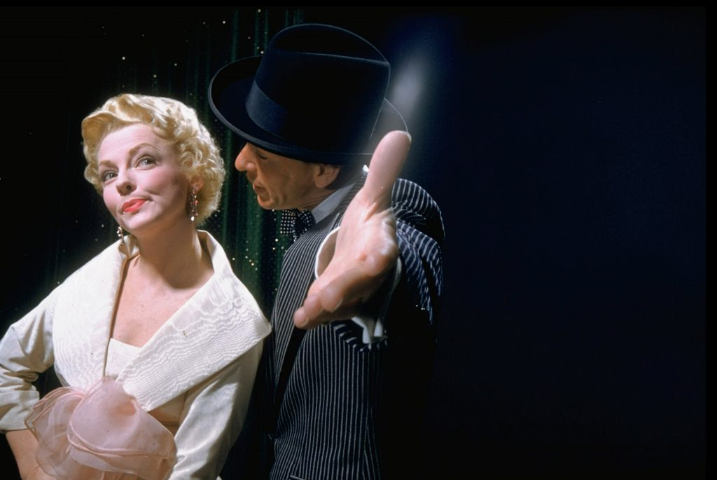 """Frank Sinatra singing to Vivian Blaine in scene from film """"Guys and Dolls,"""" 1955."""