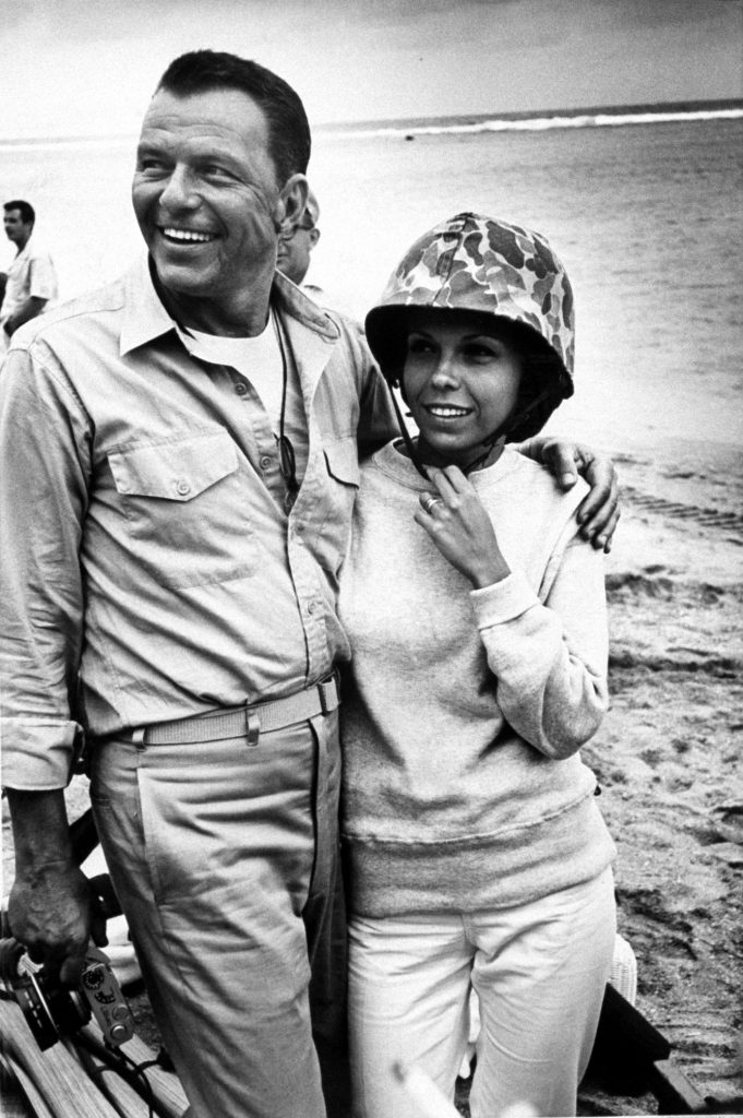 "Nancy Sinatra with father, Frank Sinatra, during producing and directing of movie ""None But The Brave,"" 1964."
