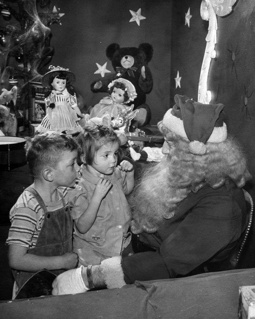 Children talking to Santa Claus, 1946.