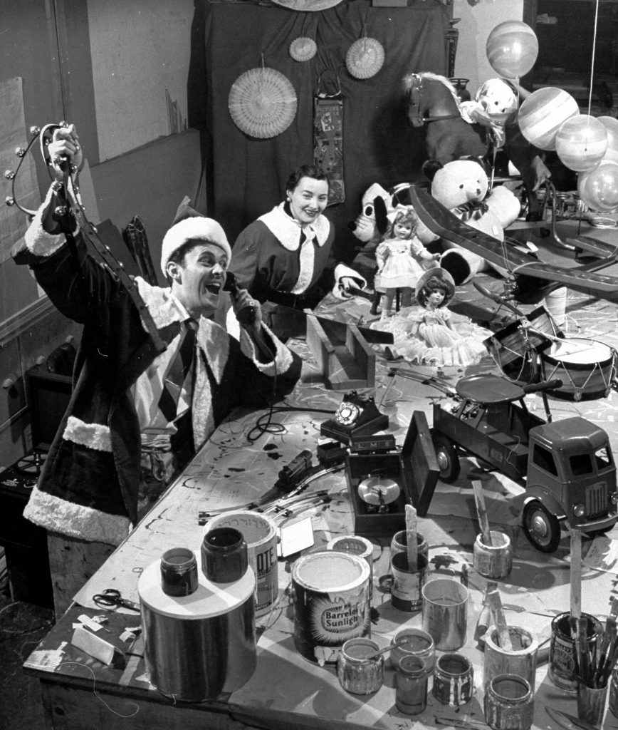 """Santa and Mrs. Claus"" answering telephone calls in their workshop at F. A. O. Schwartz, 1947."