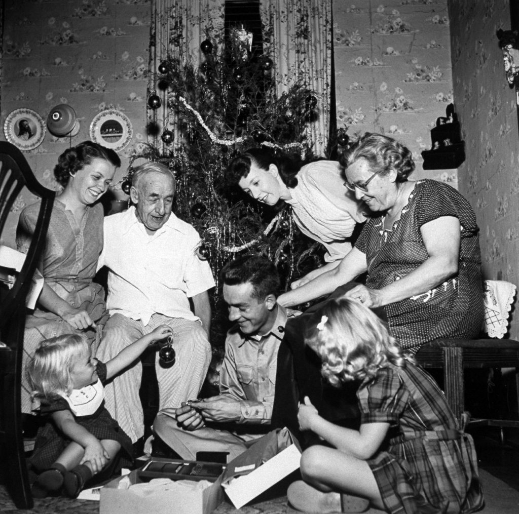 A family celebrating Christmas, 1953.
