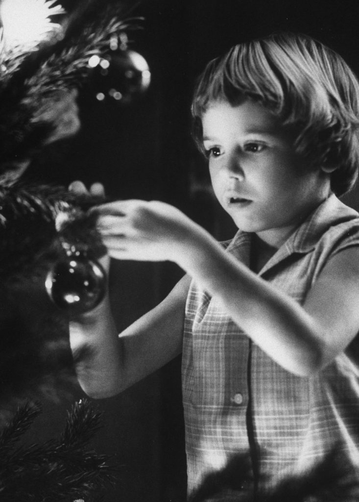 Tina Smith decorating a Christmas tree at Guantanamo Naval Base, where her dad, Lt. Commander Joe Smith is stationed, 1962.