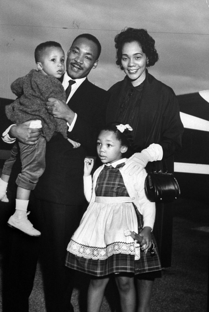 Martin Luther King Jr. holding his son Martin III as his daughter Bernice and wife Coretta greet him at the airport upon his release from Georgia State prison after incarceration for leading boycotts, 1960.
