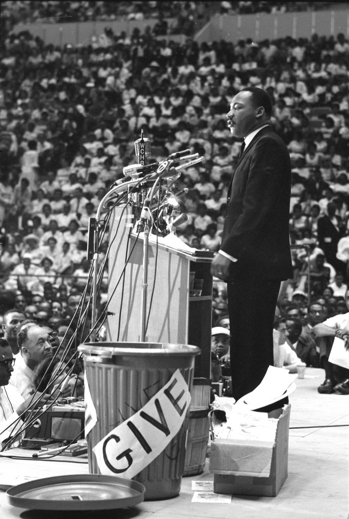 Reverend Martin Luther King Jr. addressing rally in Detroit, 1963.