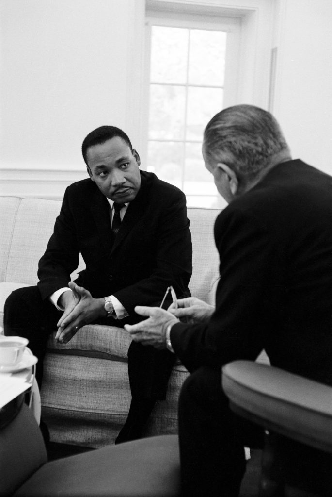 Civil rights leader Dr. Martin Luther King Jr.speaking with President Lyndon Johnson during a visit to the White House, 1963.