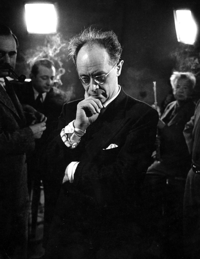 Rudolf Serkin, his hair bristling, listens with deep absorption to his Beethoven Emperor Concerto..