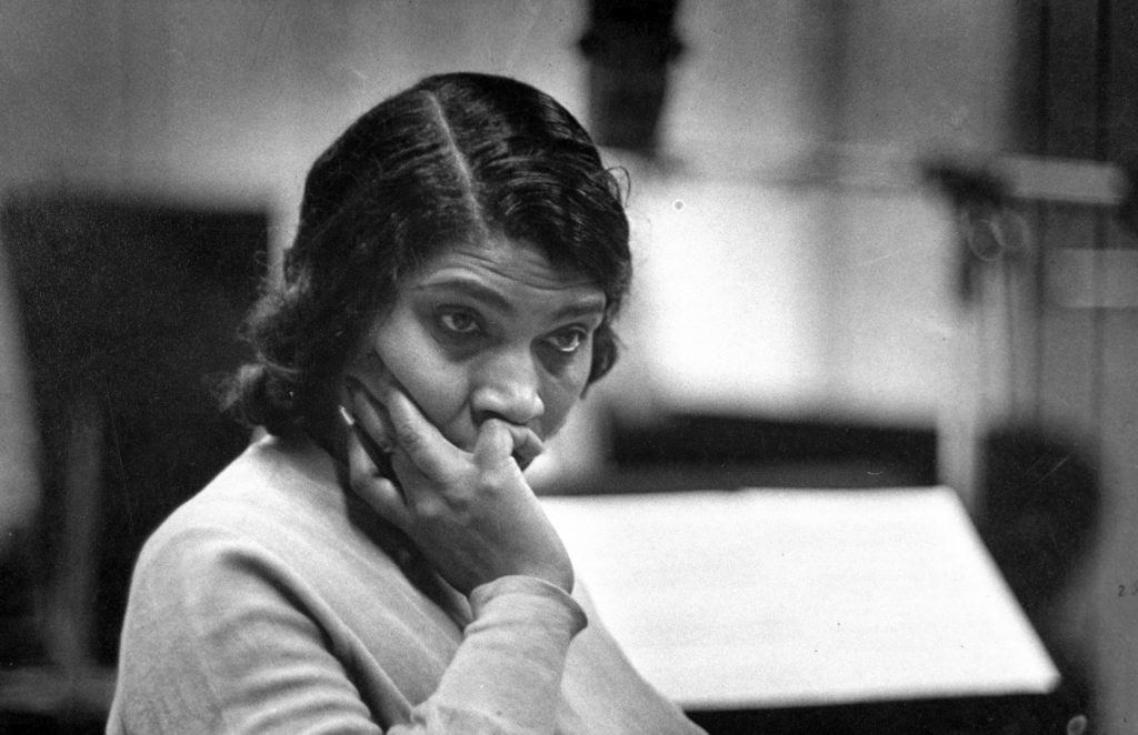 Marian Anderson listens doubtfully to her Brahams Alto Rhapsody. But orchestra applauded her.