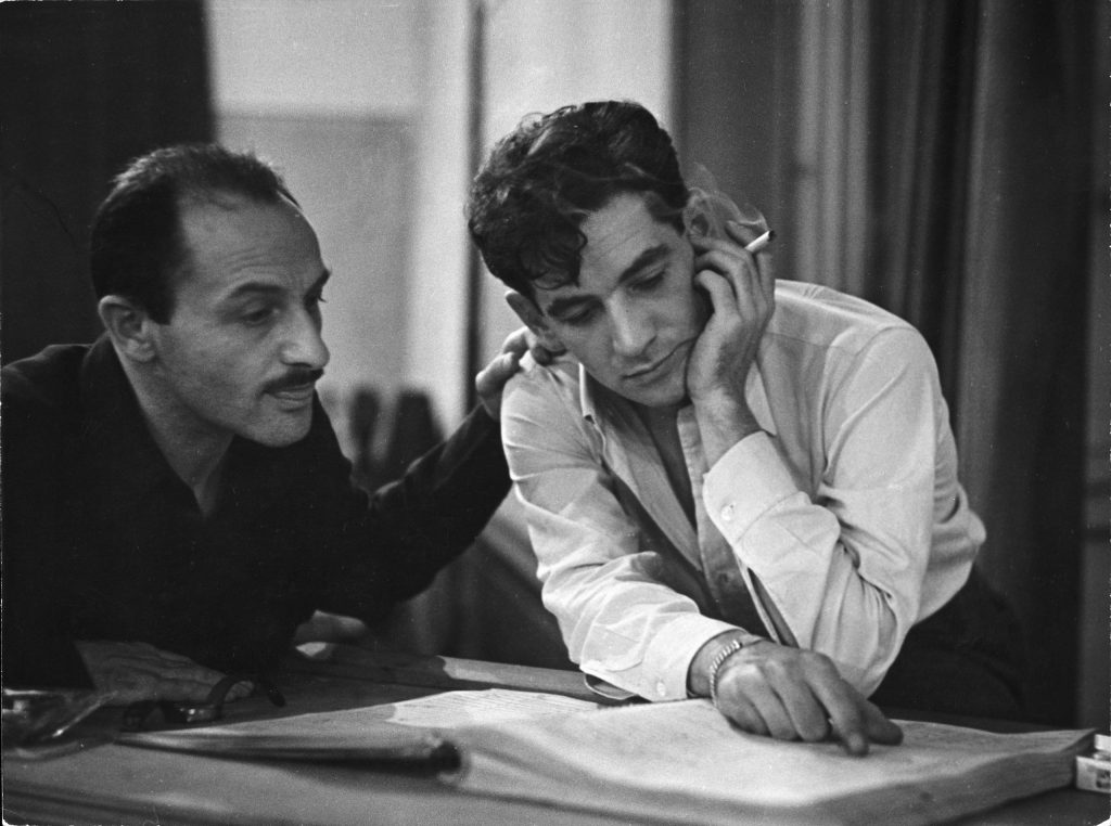Composer Marc Blitzstein with conductor/composer Leonard Bernstein studying score of a Blitzstein work during a recording session.