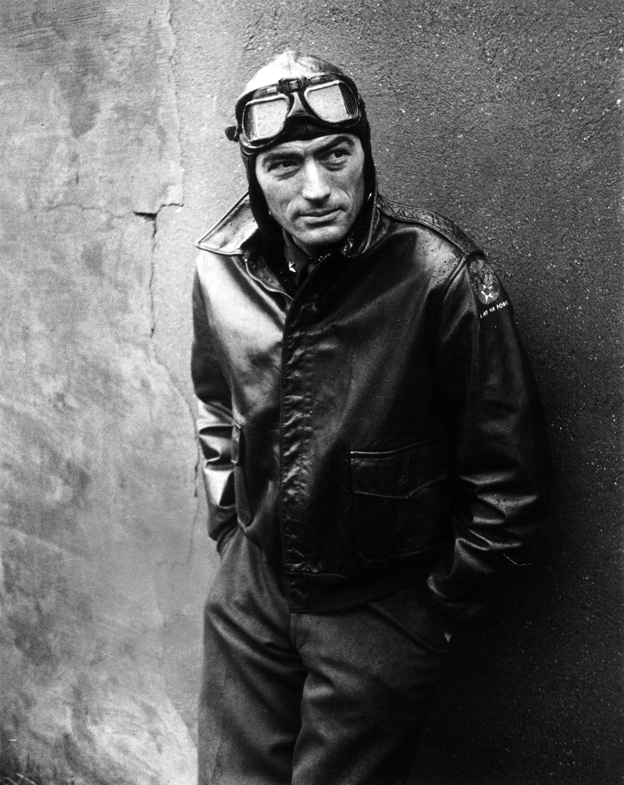 """Gregory Peck costumed as WWII American Air Forces bomber pilot for movie """"Twelve O'Clock High."""" 1950."""