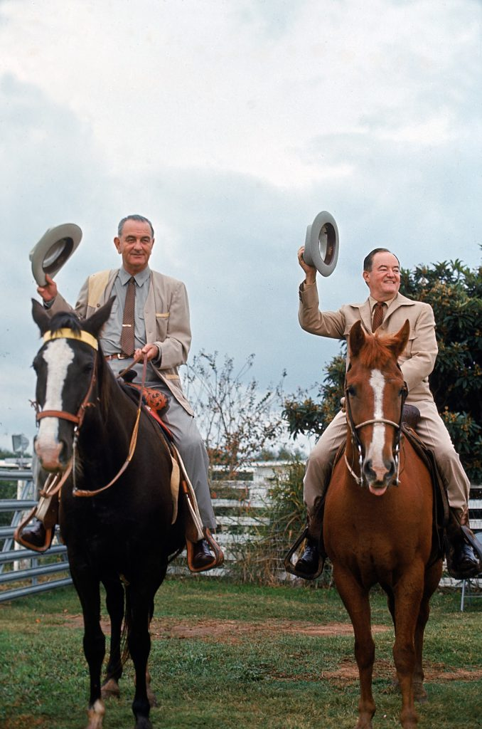 Taking the reins. At the LBJ ranch, the President and vice president-elect saddle up. Johnson outfitted Humphrey with cowboy clothes and then mounted him on a frisky quarter horse, El Rey, while he rode his Tennessee walker, Lady B. Then they went out to round up cattle. Humphrey was game but not expert.