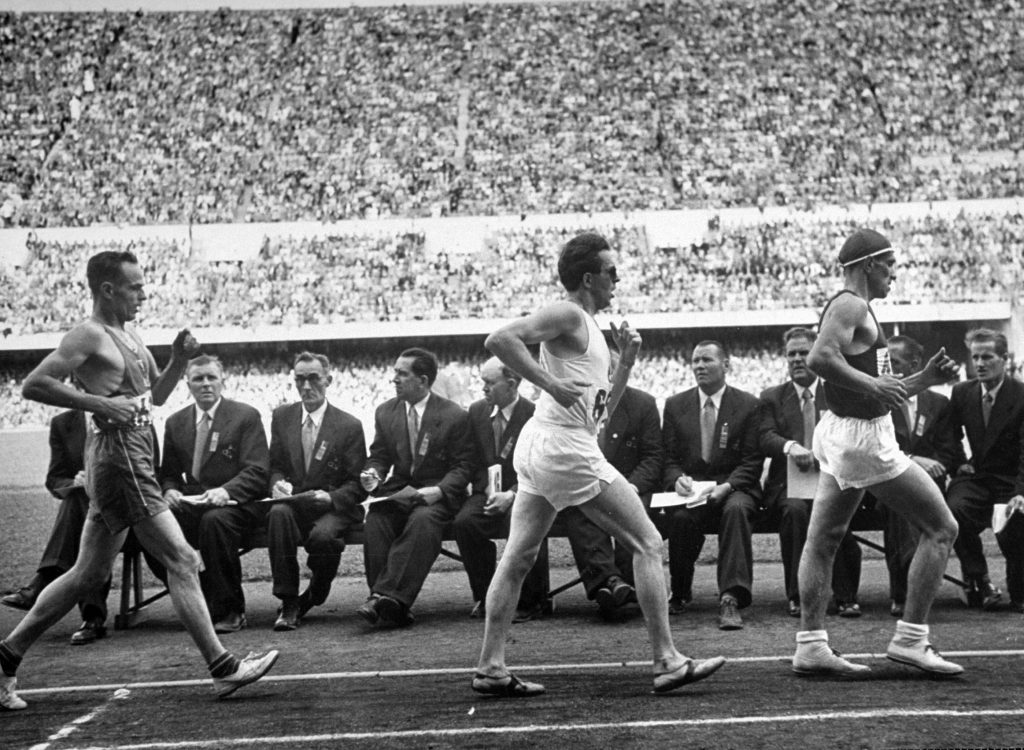 Athletes competing in the 10,000-meter walk at the 1952 summer Olympics in Helsinki, Finland.