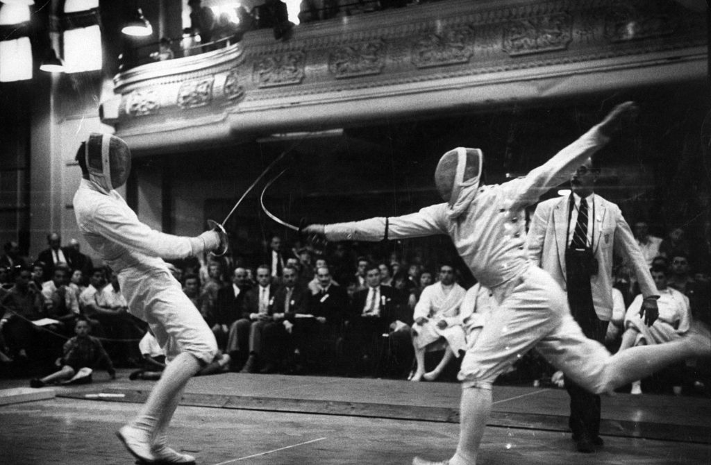 Fencers competing in the 1956 summer Olympics in Melbourne, Australia.