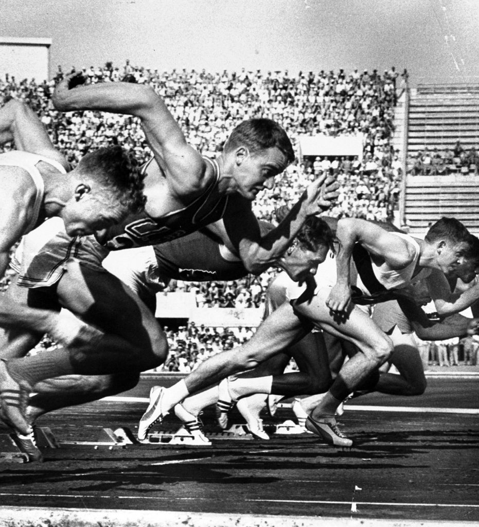 German Armin Harry (C) during men's 100-meter dash event at the 1960 summer Olympics in Rome, Italy.