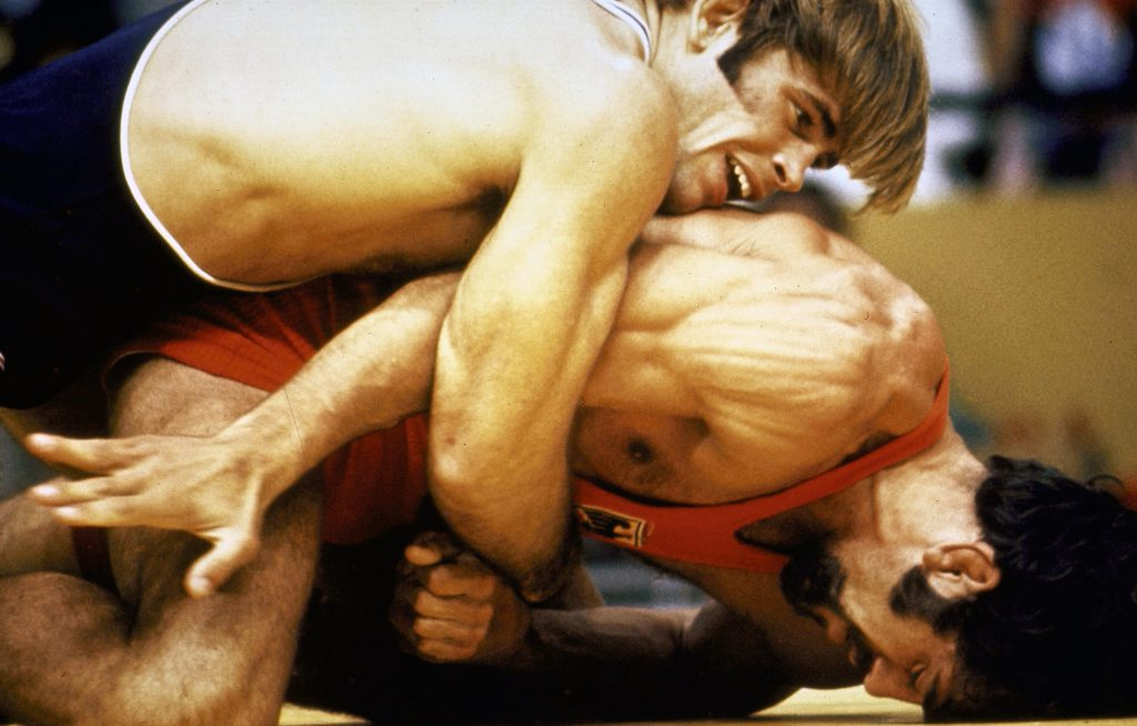 US wrestler eventual gold medal winner Wayne Wells (top) overpowering W. German Adolf Seger in freestyle welterweight elimination match at the 1972 summer Olympics in Munich, West Germany.