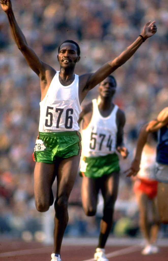 Kenyan track star Kipchoge Keino finishing ahead of teammate Ben Jipcho (574) in the 3,000-meter steeplechase final at the 1972 summer Olympics in Munich, West Germany.