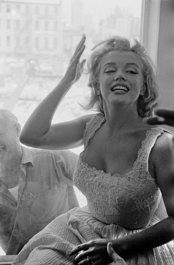 Marilyn Monroe blesses the cornerstone-laying ceremony at the Time-LIFE building with her presence. New York City, 1957.