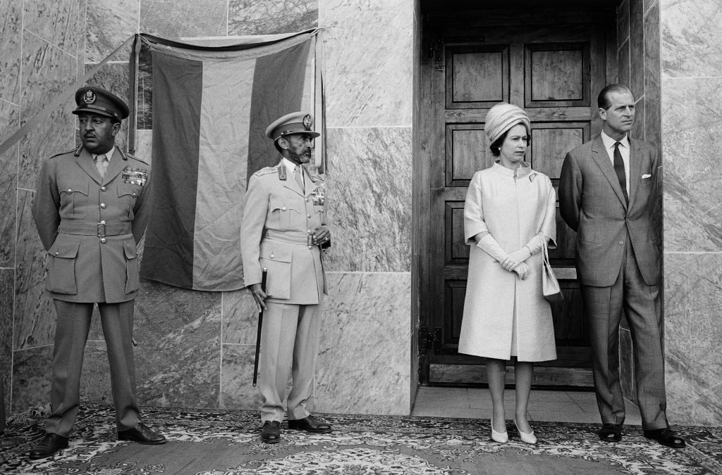 England's Queen Elizabeth II and Duke of Edinburgh wait with their hosts, Emperor Haile Selassie of Ethiopia and his son, the Crown Prince, before they enter the New Cathedral of St. Mary of Zion. Axum, Ethiopia, 1965.