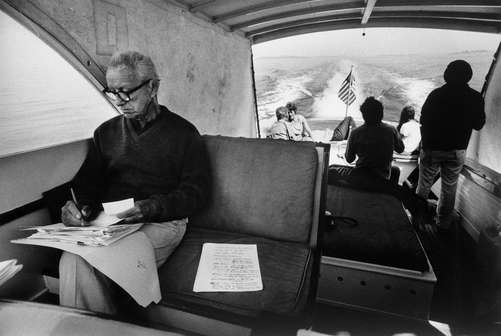 Buckminster Fuller, champion of geodesic domes, ferries houseguests to Bear Island, which his grandmother bought in 1904. It remains his family's summer seat. Penobscot Bay, Maine, 1970.
