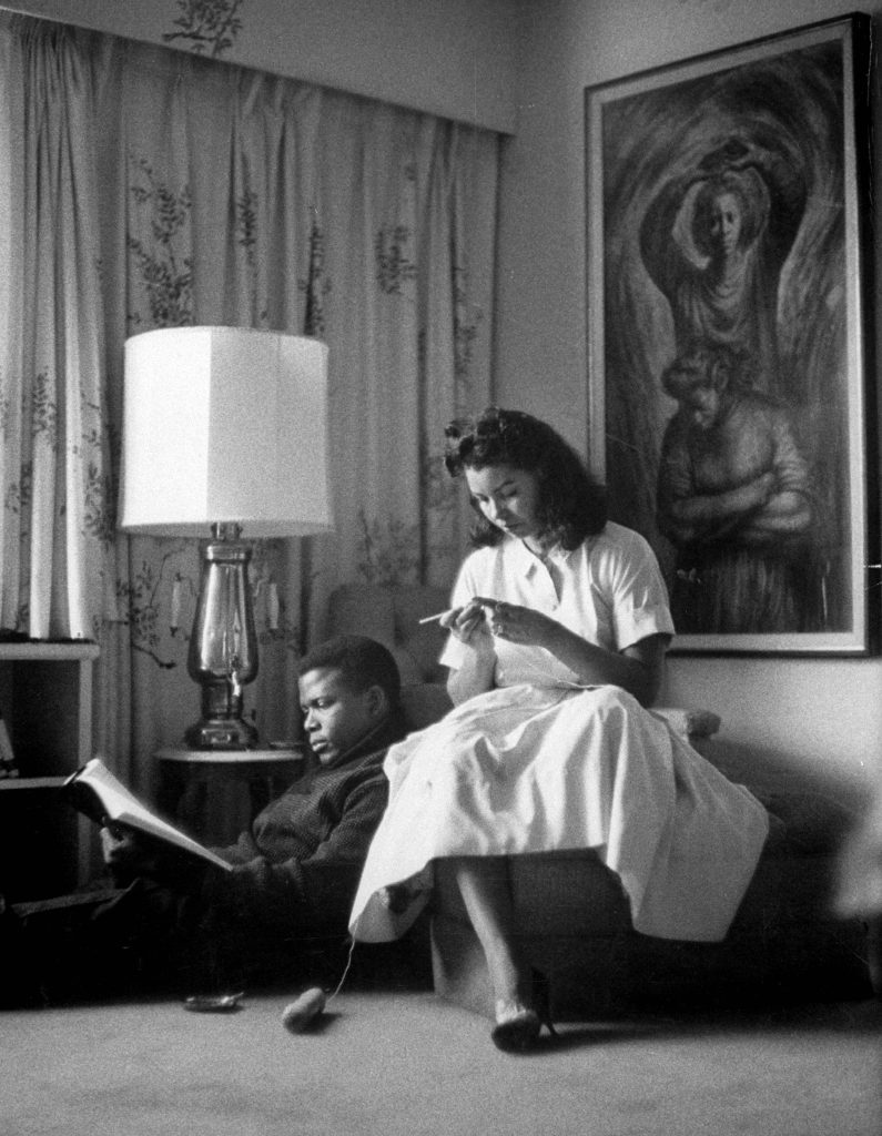 Sidney Poitier with his wife at home, 1959.