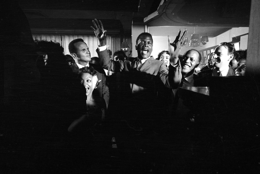 """""""Raisin in the Sun"""" party at Sardis with Harry Belafonte and Sidney Poitier, 1959."""