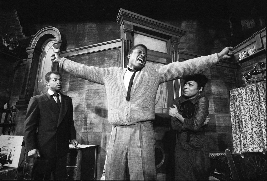 """Sidney Poitier in a dramatic scene from play """"A Raisin in the Sun"""", with Ruby Dee, 1959."""