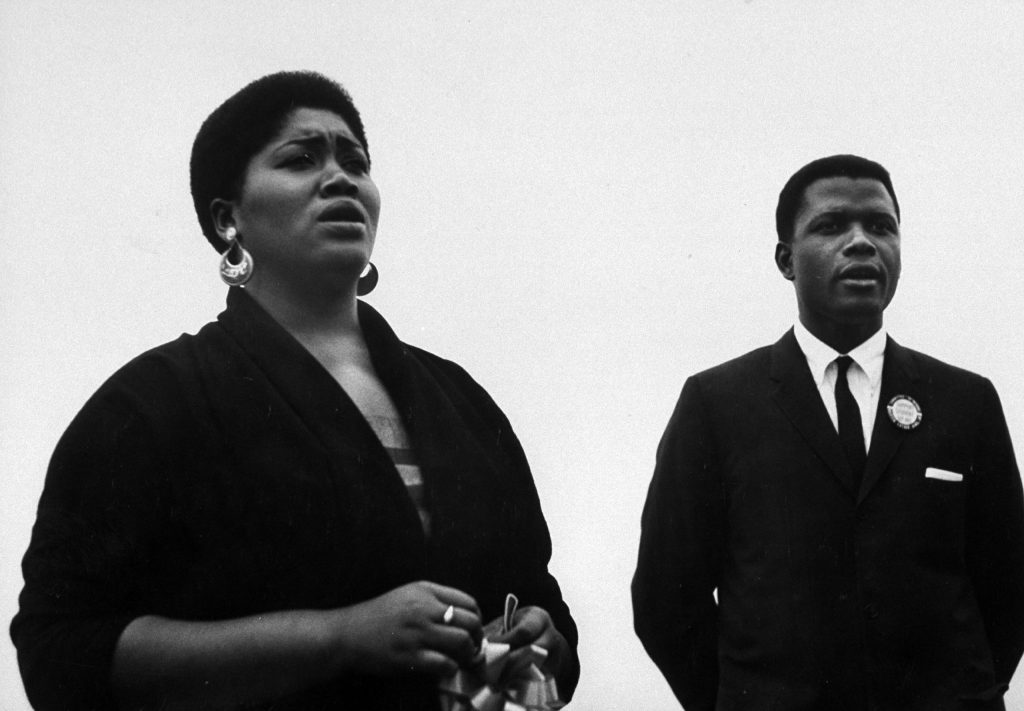 Folk singer Odetta at a civil rights rally at Statue of Liberty with Sidney Poitier, 1960.