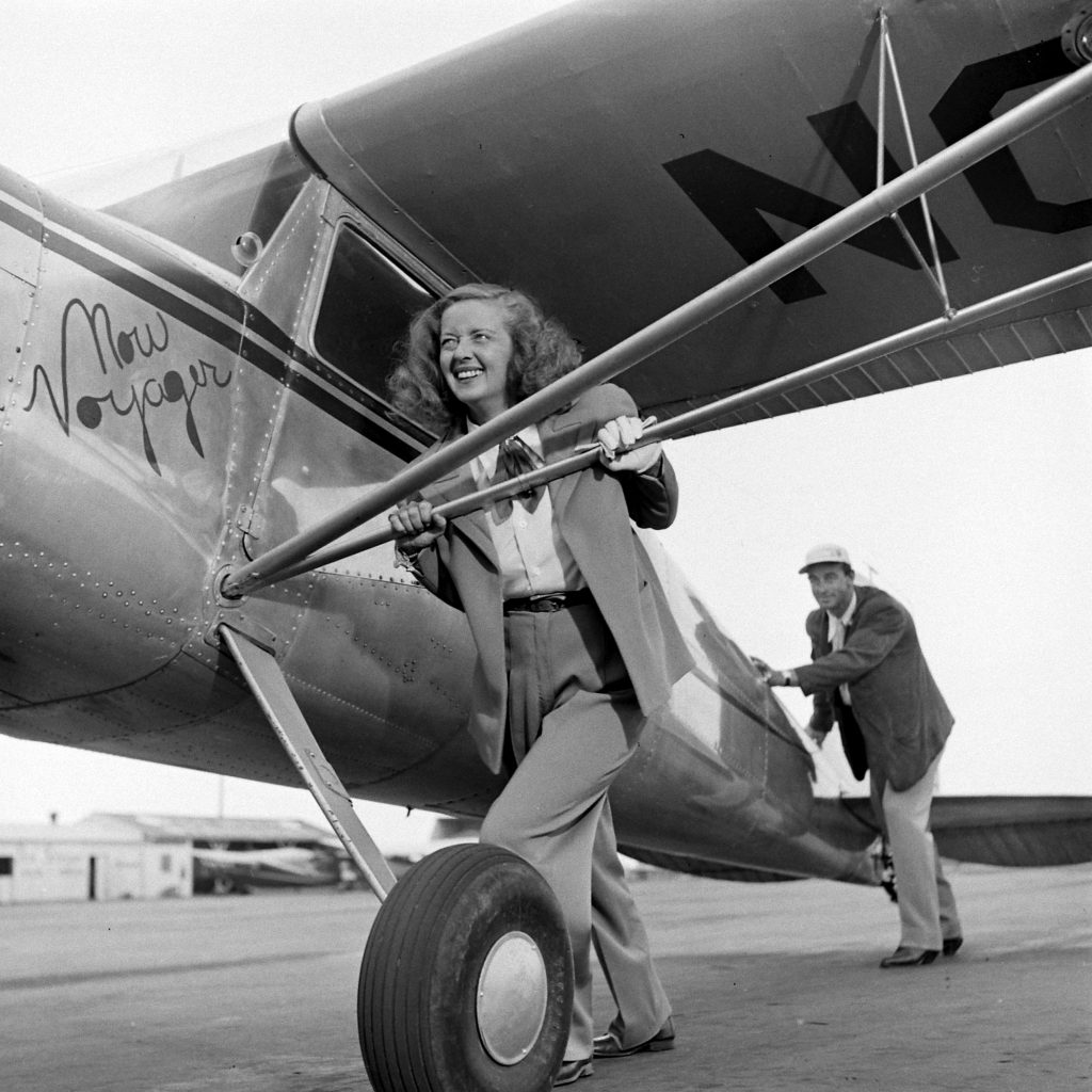 Bette Davis in front of a plane with her third husband, William Grant Sherry in California, 1947.