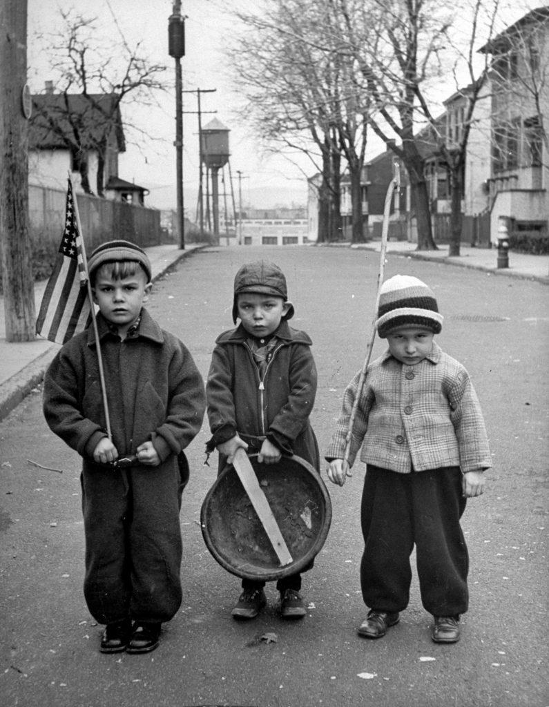 Children having military parade in street in Tarrytown, N.Y., 1944.