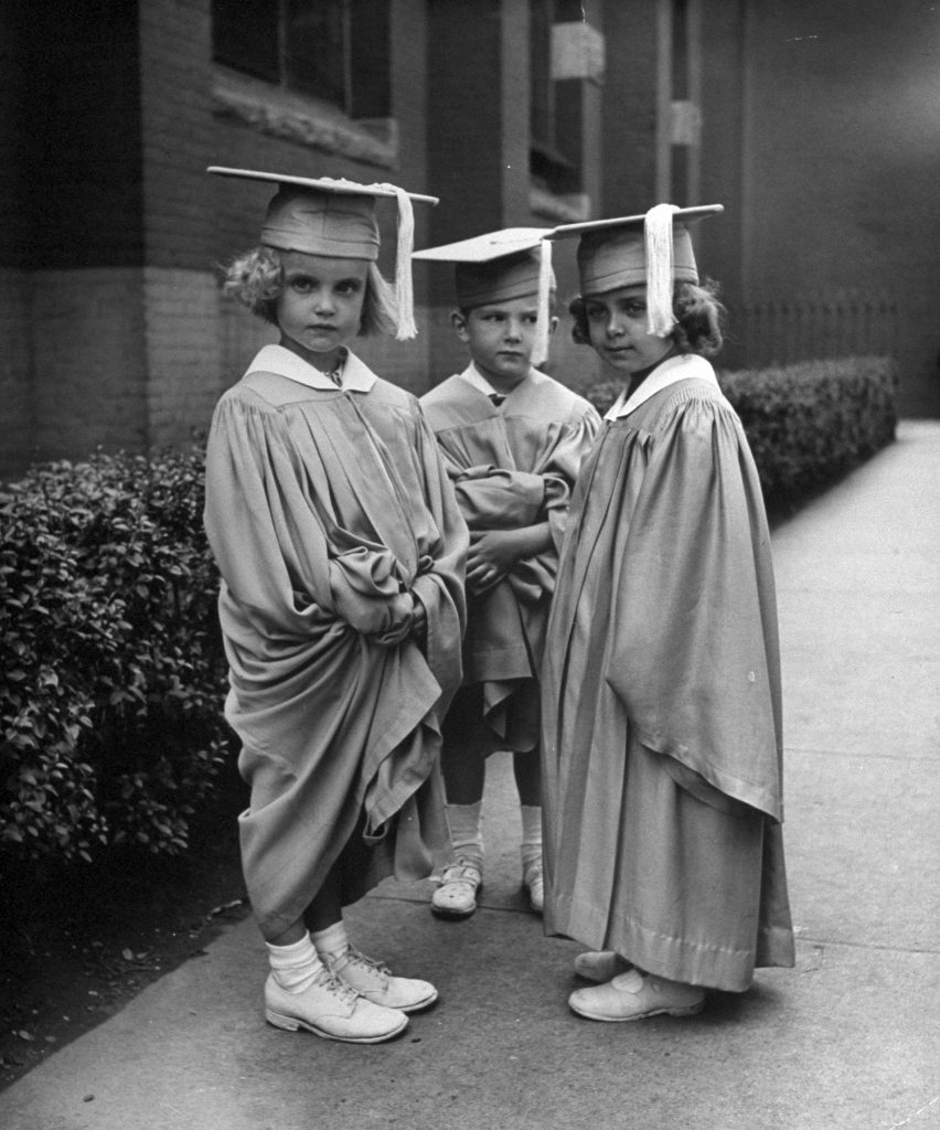 Three children graduating kindergarten in the U.S., 1945.