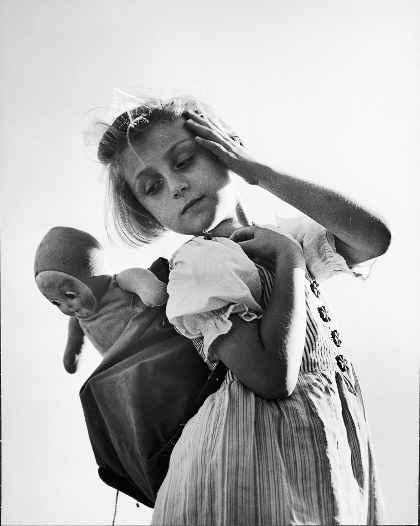 Austrian girl and her doll, 1946.