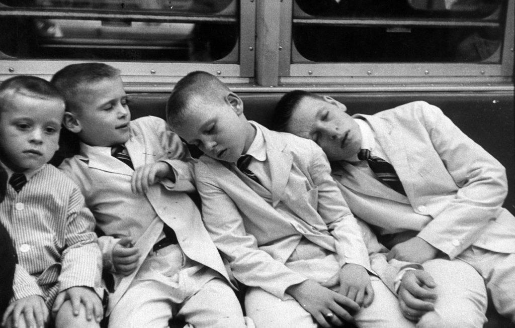 Little boys sleeping on a subway car in New York, NY, 1959.